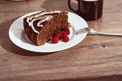 Piece of Chocolate Cake and Fresh Raspberries stock images