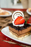 Piece of chocolate cake with  fresh strawberry Stock Photo