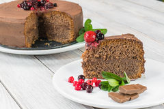 Piece of Chocolate cake with Ganache and berries fruit Stock Photos