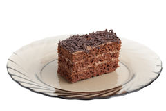 Piece of chocolate cake on a glass plate Royalty Free Stock Photography
