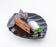 Piece of chocolate cake with ice cream and mint Stock Photo