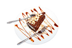 Piece of chocolate cake with icing Royalty Free Stock Images