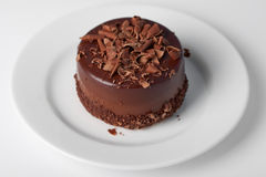 Piece of chocolate cake with icing. Piece of chocolate cake with chocolate icing Stock Photography