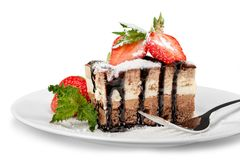 Piece of chocolate cake with icing and fresh berry Royalty Free Stock Image