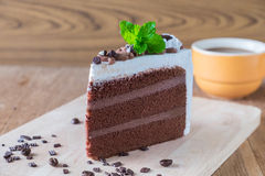 Piece of chocolate cake with icing on wooden Royalty Free Stock Photography
