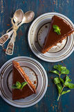 Piece of chocolate cake with mint leaves Stock Photography