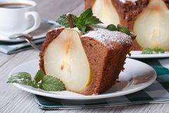 Piece of chocolate cake with pears closeup horizontal Royalty Free Stock Photography