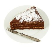 Piece of a chocolate cake in a plate Stock Photography
