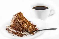 Piece of chocolate cake on a plate and black coffee Stock Photos