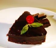 Piece of chocolate cake on a plate. Fresh piece of cake with chocolate cream on a plate Stock Photography