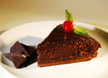 Piece of chocolate cake on a plate. Stock Image