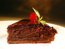 Piece of chocolate cake on a plate. Royalty Free Stock Photo