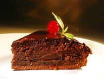 Piece of chocolate cake on a plate. Fresh piece of cake with chocolate cream on a plate Royalty Free Stock Photo