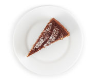 Piece of chocolate cake in plate isolated Royalty Free Stock Photography