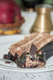 Piece of chocolate cake in shallow focus on a plate Royalty Free Stock Image