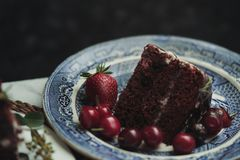 A piece of a chocolate cake with strawberries and blackberries stock photos