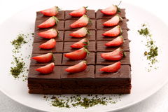 Piece of chocolate cake with strawberry. Royalty Free Stock Photos