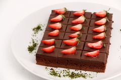 Piece of chocolate cake with strawberry. Royalty Free Stock Photography