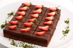 Piece of chocolate cake with strawberry. Stock Images