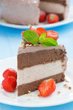 Piece of chocolate cake of three layers with fresh strawberries. Close-up, vertical Stock Photo