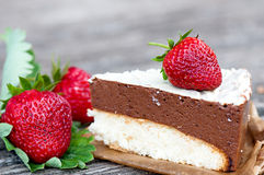Piece of chocolate cake. Of two layers with fresh strawberries Royalty Free Stock Images