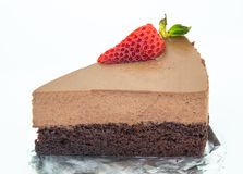 Piece of chocolate cake of two layers with fresh strawberries on Stock Photography