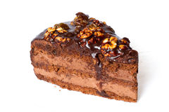 Piece of chocolate cake with walnuts. Royalty Free Stock Images