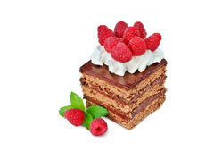 Piece of chocolate cake with whipped cream icing and  raspberries isolated Stock Photos