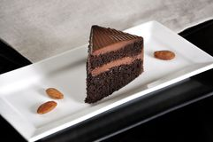 Piece of Chocolate Cake on White Plate. With almonds stock photos