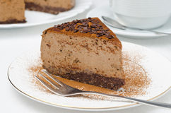 Piece of chocolate cheesecake on a plate closeup horizontal Stock Images