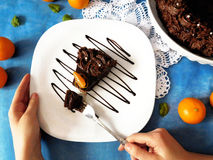 A piece of chocolate cheesecake on a plate. Decorated with chocolate glazing stock photo