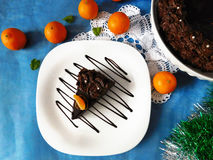 A piece of chocolate cheesecake on a plate. Decorated with chocolate glazing royalty free stock photos