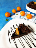 A piece of chocolate cheesecake on a plate. Decorated with chocolate glazing royalty free stock photography
