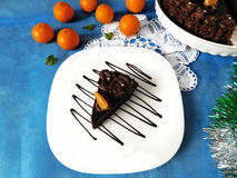 A piece of chocolate cheesecake on a plate. Decorated with chocolate glazing royalty free stock images