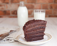 A piece of chocolate fudge cake with milk Royalty Free Stock Image