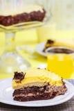 Piece of chocolate layer cake on white ceramic plate Stock Photo