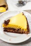 Piece of chocolate layer cake on white ceramic plate Stock Image