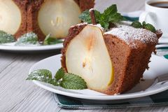 Piece of chocolate pear cake on a background of a cake Royalty Free Stock Photography