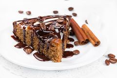 Piece of chocolate pie drizzled with chocolate syrup Royalty Free Stock Image