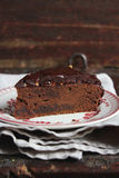 Piece of chocolate pound cake with dark chocolate frosting Stock Photography