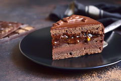 Piece of chocolate Sacher torte on a black plate on a slate,ston Stock Images