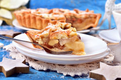 Piece of christmas apple pie with star shape decoration Royalty Free Stock Photo