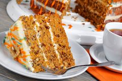 Piece of classic carrot cake and tea stock photography