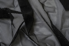 Piece of cloth. A piece of black mesh fabric Stock Photo