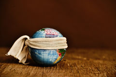 Piece of cloth tied around a terrestrial globe Royalty Free Stock Images