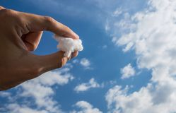 A Piece of Cloud Sky. A Piece of Cloud in the Hand between Fingers Stock Photos