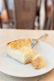 Piece of coconut cake. On white plate with a fork Royalty Free Stock Photo