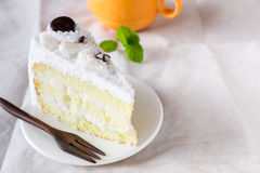 Piece of coconut cake with icing on white Stock Photography