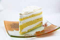 A piece of coconut cake on white background Stock Images