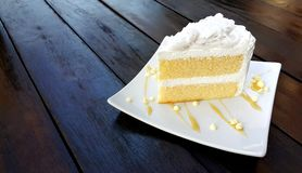 Piece of coconut cake in white plate